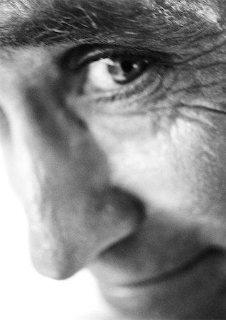 Mature man looking at camera, extreme close-up, b&w Stock Photo - Premium Royalty-Free, Code: 695-03385963