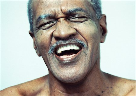 Senior man laughing, portrait, close-up Stock Photo - Premium Royalty-Free, Code: 695-03385970