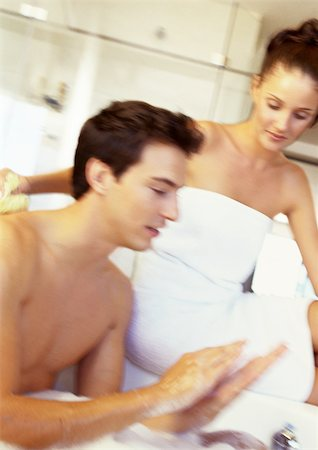 Woman sitting beside man having bath Stock Photo - Premium Royalty-Free, Code: 695-03386530