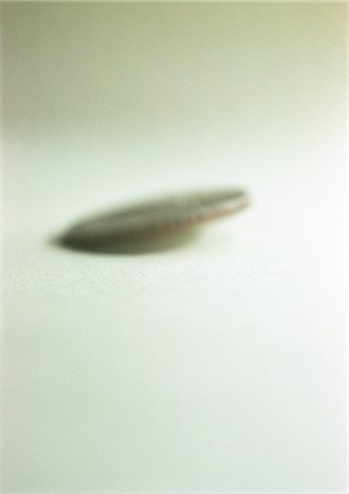Coin, falling, blurred, close-up Stock Photo - Premium Royalty-Free, Code: 695-03386962