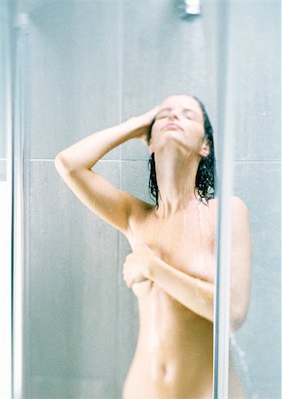 Woman taking shower, covering breast Stock Photo - Premium Royalty-Free, Code: 695-03387026