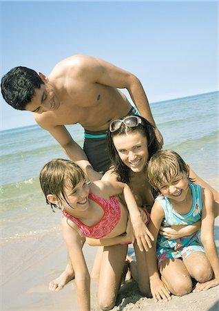 Family on beach, smiling Stock Photo - Premium Royalty-Free, Code: 695-03388952