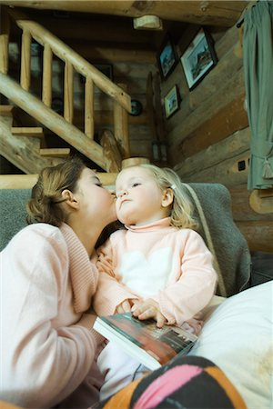 preteen kissing - Girl and toddler sitting on couch, kissing cheek Stock Photo - Premium Royalty-Free, Code: 695-03389352