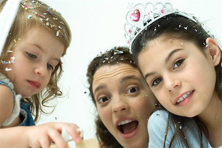 family image and confetti - Mother and two daughters celebrating with confetti Stock Photo - Premium Royalty-Free, Code: 695-03389855