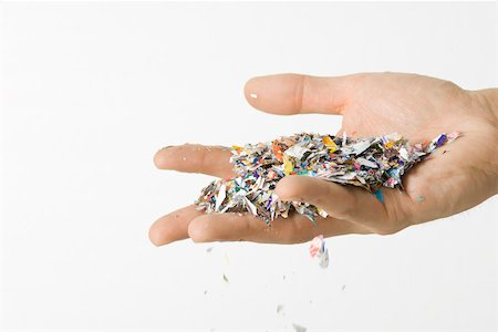 Hand holding confetti, cropped view Stock Photo - Premium Royalty-Free, Code: 695-03380285