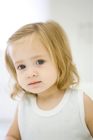 shy baby - Toddler girl looking at camera, portrait Stock Photo - Premium Royalty-Free, Code: 695-03380609