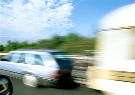 road landscape - Station wagon with mobile home attached, blurred motion Stock Photo - Premium Royalty-Free, Code: 695-03380958