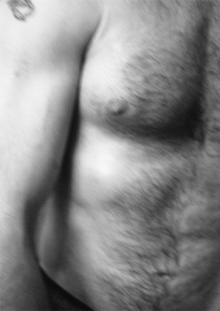 Man's bare torso, close-up, b&w Stock Photo - Premium Royalty-Free, Code: 695-03382111