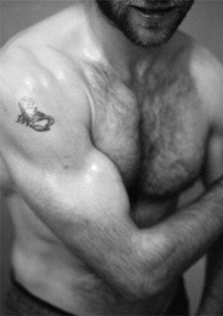 Man's bare torso, b&w Stock Photo - Premium Royalty-Free, Code: 695-03382130