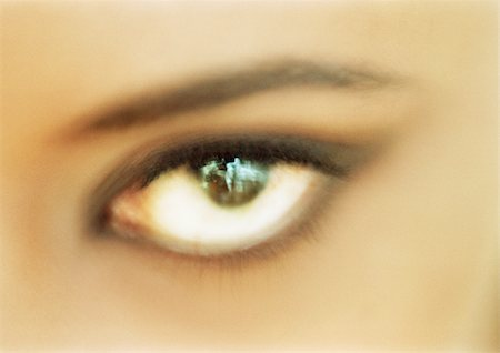 Woman's brown eye looking at camera, blurred close up. Stock Photo - Premium Royalty-Free, Code: 695-03383009