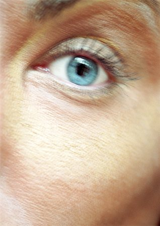 Woman's blue eye, looking at camera, blurred close up. Stock Photo - Premium Royalty-Free, Code: 695-03383082