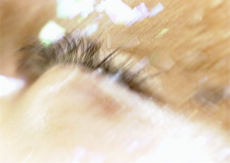Woman's closed eye, make-up on face, extreme close-up, blurry. Stock Photo - Premium Royalty-Free, Code: 695-03383134