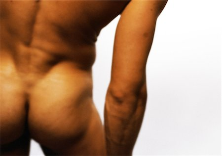 Nude man's buttocks and arm, close-up Stock Photo - Premium Royalty-Free, Code: 695-03383547