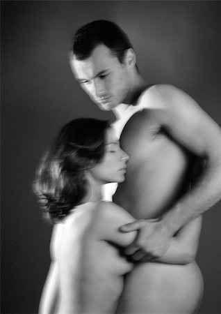 Nude man and woman embracing, blurred black and white. Stock Photo - Premium Royalty-Free, Code: 695-03383720