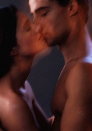 Nude man and woman kissing, blurred, close-up Stock Photo - Premium Royalty-Free, Code: 695-03383737