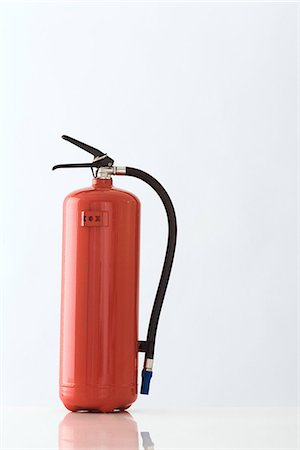 prevention - Red fire extinguisher, close-up Stock Photo - Premium Royalty-Free, Code: 696-05780736