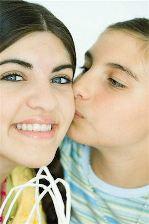 preteen kissing - Two young female friends, one kissing the other on the cheek Stock Photo - Premium Royalty-Free, Code: 696-03394063