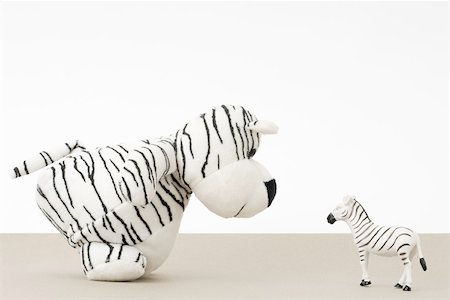 Toy tiger facing toy zebra, side view Stock Photo - Premium Royalty-Free, Code: 696-03396091