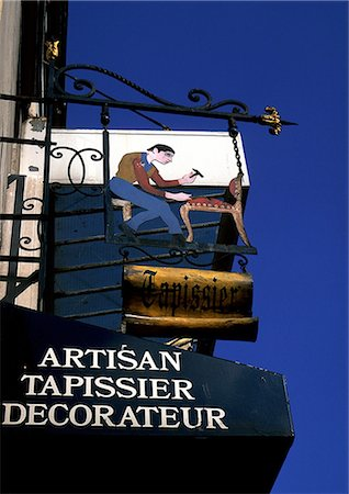 designer backgrounds - Upholsterer shop sign in French Stock Photo - Premium Royalty-Free, Code: 696-03396478