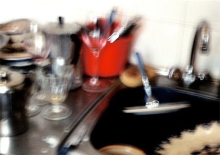 Dishes by sink, blurred. Stock Photo - Premium Royalty-Free, Code: 696-03397309