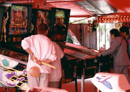 pinball - People playing pinball at arcade. Stock Photo - Premium Royalty-Free, Code: 696-03397352