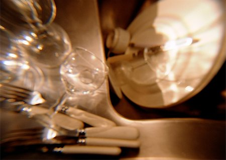 Dishes, glasses, silverware, blurred Stock Photo - Premium Royalty-Free, Code: 696-03398193