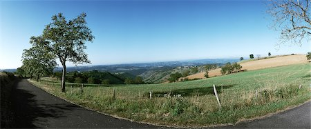 road landscape - France, country road along fields, panoramic view Stock Photo - Premium Royalty-Free, Code: 696-03398736