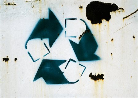 stencil - Recycling symbol on rusty surface, close-up Stock Photo - Premium Royalty-Free, Code: 696-03398785