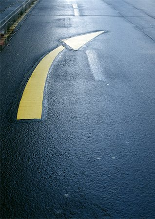 right - Directional arrow on road, close-up Stock Photo - Premium Royalty-Free, Code: 696-03398839