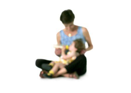 Silhouette of woman feeding bottle to girl on lap, on white background, defocused Stock Photo - Premium Royalty-Free, Code: 696-03399916