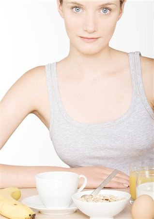 Young woman with large breakfast Stock Photo - Premium Royalty-Free, Code: 696-03400151