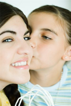 preteen kissing - Two young female friends, one kissing the other on the cheek Stock Photo - Premium Royalty-Free, Code: 696-03401557