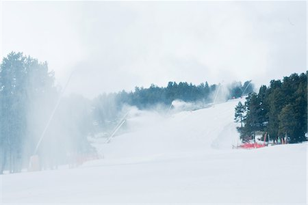 Ski slopes, artificial snow being sprayed Stock Photo - Premium Royalty-Free, Code: 696-03402004