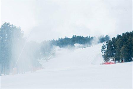 Ski slopes, artificial snow being sprayed Stock Photo - Premium Royalty-Free, Code: 696-03402004