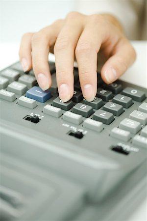 Woman's hand using adding machine, close-up Stock Photo - Premium Royalty-Free, Code: 696-03402738