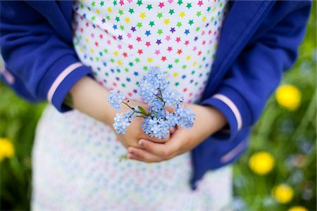 polka dot - Midsection of little girl (4-5) holding blue flowers Stock Photo - Premium Royalty-Free, Code: 698-05956509