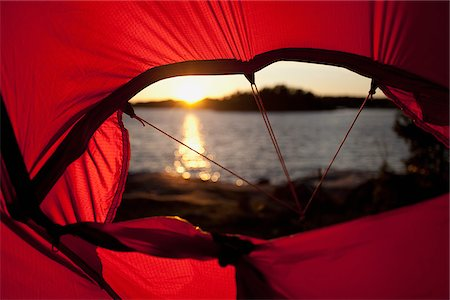 Sunset in tent Stock Photo - Premium Royalty-Free, Code: 698-05957522