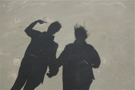 Shadow of couple on sand at beach Stock Photo - Premium Royalty-Free, Code: 698-05957863