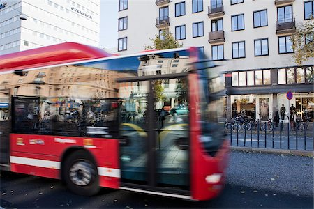 Bus driving in city Stock Photo - Premium Royalty-Free, Code: 698-05958027