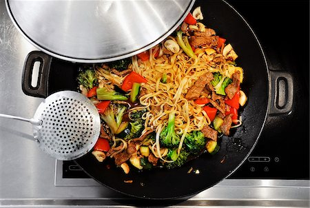 stove - Cooking vegetable stir-fry in a wok Stock Photo - Premium Royalty-Free, Code: 698-05958845