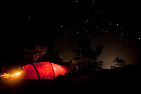 Glowing tent against night sky Stock Photo - Premium Royalty-Free, Code: 698-05958952