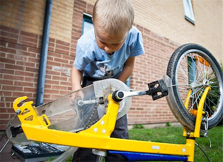 Boy repairing cycle Stock Photo - Premium Royalty-Free, Code: 698-05959028