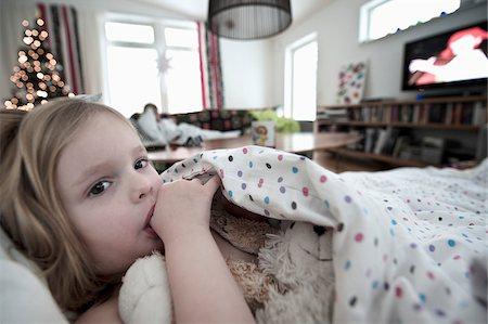 sucking - Girl resting in sofa white sucking thumb Stock Photo - Premium Royalty-Free, Code: 698-05959122