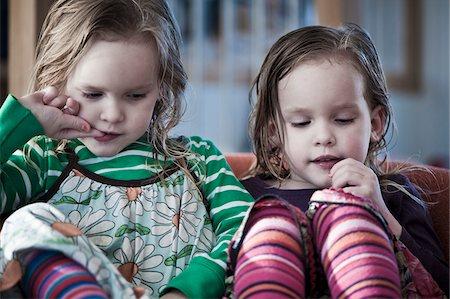 Girls in armchair Stock Photo - Premium Royalty-Free, Code: 698-05959141