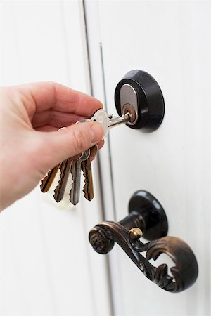 Hand unlocking the door Stock Photo - Premium Royalty-Free, Code: 698-05959288