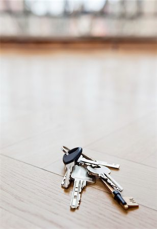 Bunch of keys lying on floor Stock Photo - Premium Royalty-Free, Code: 698-05959319