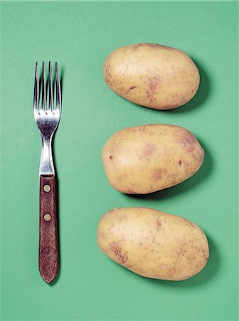 fork - Potatoes with fork over colored background Stock Photo - Premium Royalty-Free, Code: 698-06116604
