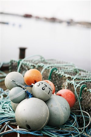 Close-up of fishing equipment buoy Stock Photo - Premium Royalty-Free, Code: 698-06116868