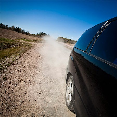 Black car moving fast on dirt road while blowing dust in air Stock Photo - Premium Royalty-Free, Code: 698-06117029