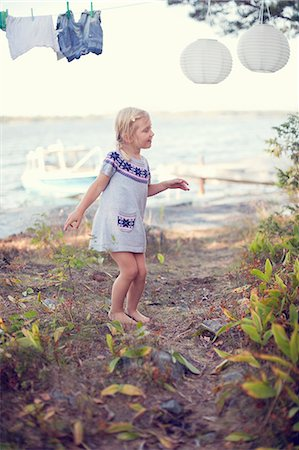 Girl dancing in the backyard of a house Stock Photo - Premium Royalty-Free, Code: 698-06117068